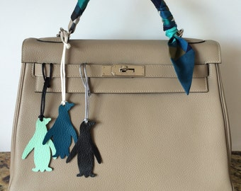Leather penguin bag charm on silk cord