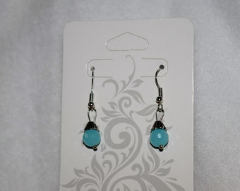 Light blue drop earrings.