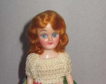 Erin , 8 inch dress up doll, crocheted outfit, with stand.