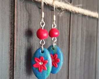 Blue and green earrings with red flowers