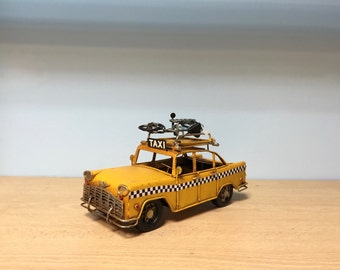 Vintage yellow NYC taxi miniature with photo frame and bicycle on its roof, retro collection, decorative collectible,NYC miniature model