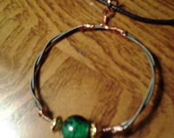 Guitar string necklace green glass bead