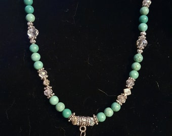 Magnesite and silver tone cross necklace