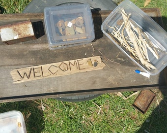 Handmade Welcome Sign on River Wood with Pebble Feet