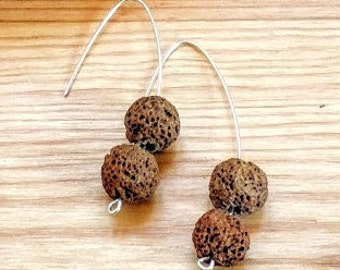 Earrings in silver with volcanic balls in brown color.