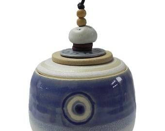 Thrown Ceramic pot with ceramic discs and bead lid.