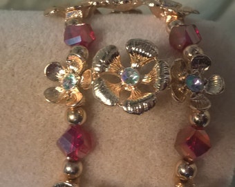 Double strand Gold and Ruby bracelet.
