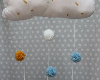 Mobile cloud-shaped tassels pink, blue, white and mustard