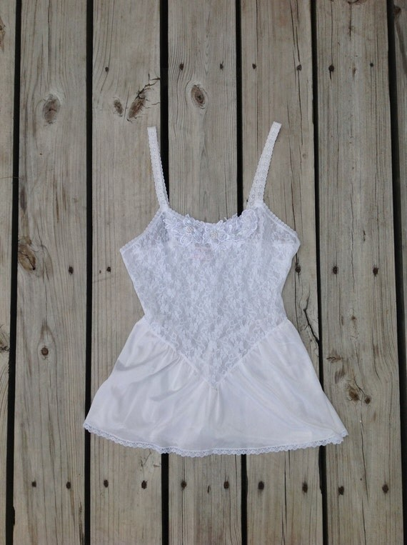 Vintage white spaghetti strap lace and silk lingerie tank top. Embroidered flowers with beads. Peplum shape and lace edging. Size small-med