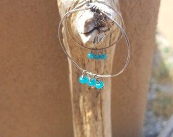 Hammered and oxodized sterling sliver hoops with teal dyed jade beads