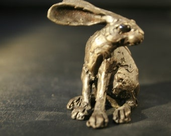 Tiny Bronze turning Hare Sculpture By Paul Jenkins