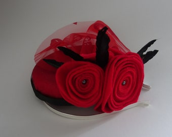 Red felt pill box fascinator hat with veil and roses