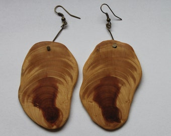 Natural edge wooden earrings made from salvaged juniper
