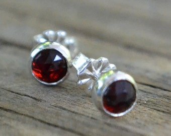 garnet and sterling silver faceted stud earrings