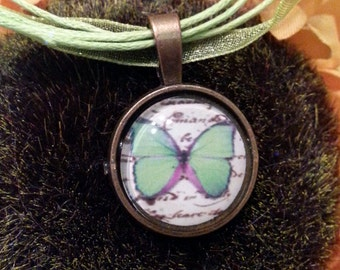 Green Butterfly cabochon pendant on a green chiffon cord necklace