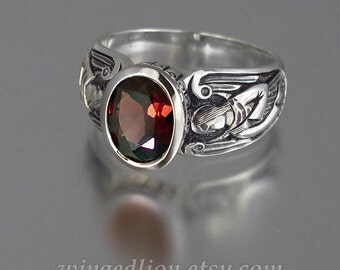 GUARDIAN ANGELS silver ring with faceted Garnet (sizes 5-8.5)