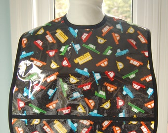 Cars to Go and Yellow Dino Extra Large Adult Bib - vinyl covered extra-large bib with pocket