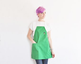 kelly green apron cover . tiny embroidered PENGUIN bird .sale s a l e