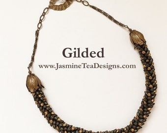 Gilded, Galvanized Gold And Matte Metallic Dark Olive Iris Long Magatama Beads, 20 Inch Kumihimo Necklace With Antique Brass Details