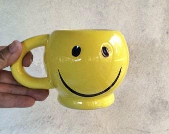 Vintage bright yellow smiley mug, smiley coffee cup with thick handle, retro glazed smiley face mug on pedestal base, genuine smiley mug