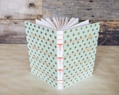 Handmade journal with mint green and gold cover, sewn with icicle binding
