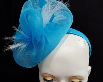 Bright blue fascinator crin horsehair and feather blue and white headband fixing wedding or races