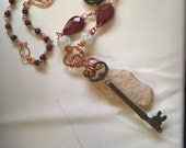Eclectic art jewelry antique key and pacific northwest beach stone with tiger iron moonstone red agate and handmade glass - The Universe Key