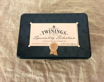 "Two VINTAGE metal Twinings of London tea tins ""English Breakfast and Speciality Selection"". VINTAGE ADVERTISING. Made in England."