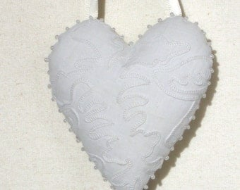 White vintage embroidered heart ornament with pearl