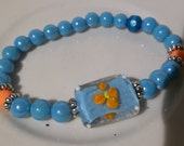 Light Blue with Orange Flower-Lampwork- Beautiful-Blue Satin Pearls- Beaded Stretch Bracelet  (330)