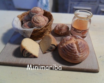 Miniature board with bread, cheese and honey