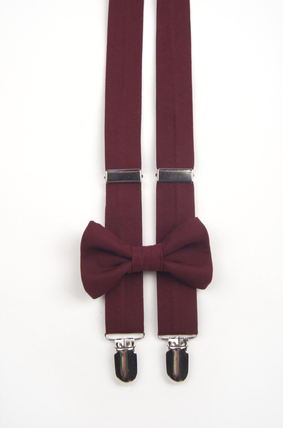 Complete your stylish bow tie look with fashionable men's suspenders. Available in an array of solid colors at discount prices.