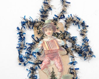 Early 1900's Victorian German Boy Embossed Die Cut and Blue Tinsel Christmas Scrap Ornament