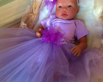 From the Biracial Shyann Kit Baby Girl Carla Complete Baby Doll with Magnetic Pacifier