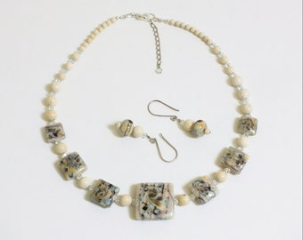 Lovely Lampwork / and Ivory Beaded necklace with dark gray swarovski  spacers w/matching earrings