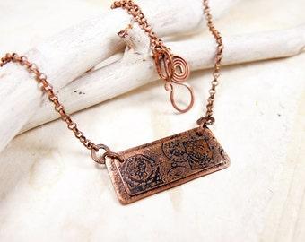 Copper postal necklace.