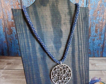 Blue and Silver Beaded Necklace with a Circle of Stars Pendant