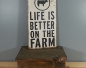 Life is Better on the Farm, circle with cow, hand painted, distressed, rustic wooden sign.