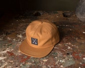 MD Quality Goods Original Snapback Cap / Brown Canvas With Crossed Arrows Logo Patch