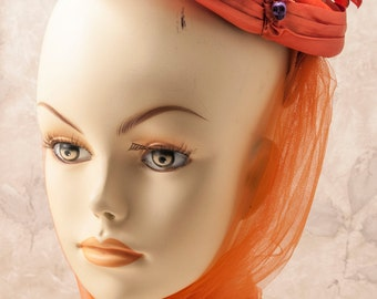 vintage orange fascinator embellished for Halloween. Skulls, beads
