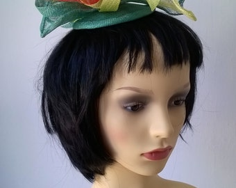 Green and orange flower inspired fascinator