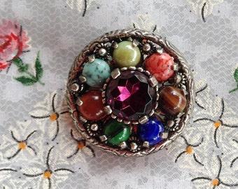 signed MIRACLE PEBBLE BROOCH Fruit Salad Round Pendant Britain Pewter Metal Colorful Gems Amethyst Rhinestone Antiqued Metal Multicolored
