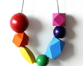Wear a rainbow.  Hand painted rainbow wooden beaded necklace, choose your own rainbow adventure