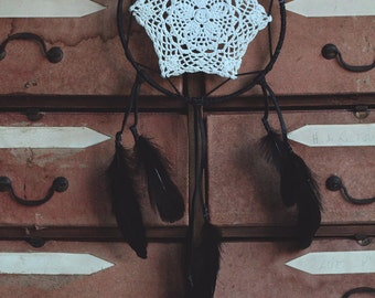 Huge black dream catcher made with leather and feathers.