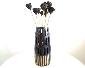 Black and tan cut-out speckled stoneware vase, ceramic vase