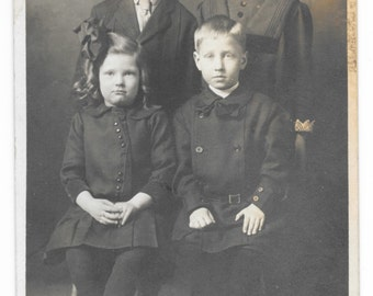 Serious Quartet Photo Postcard, c. 1910