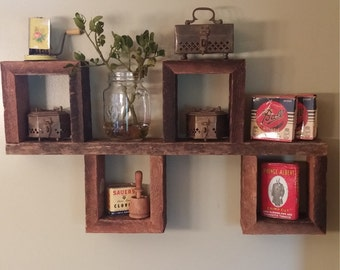 Floating box shelf handmade from vintage weathered barn wood into a unique display wall shelf