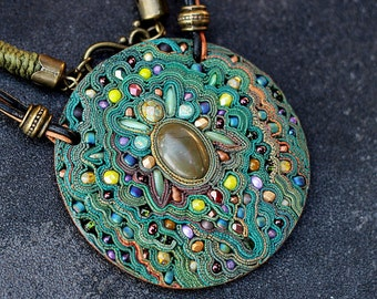 pendant of polymer clay with green beads
