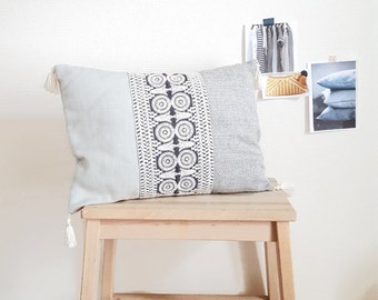 Small removable Bohemian embroidered grey white cushion and tassels sold with the cushion. Mixed fabrics - Bohemian - ethnic - deco