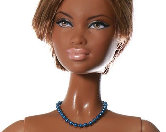 Doll trinket (necklace): Larson